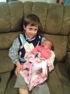 Cooper is so proud to hold his little cousin Kenadee!